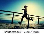 sporty female runner running on ... | Shutterstock . vector #780147001