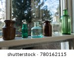 Early Glass Bottles In A Row O...