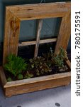 Small photo of Flower bed, miniature, wooden rustic arty decoration