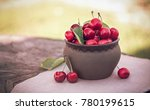 cherries in ceramic bowl. red... | Shutterstock . vector #780199615