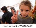 a girl of syrian refugees sends ...   Shutterstock . vector #780206461