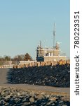 Small photo of New Bedford, Massachusetts, USA - December 21, 2017: Access road and walking path along hurricane barrier at entrance to New Bedford harbor
