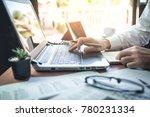businessman working on desk... | Shutterstock . vector #780231334