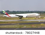 DUSSELDORF, GERMANY - MAY 21: Airplane Boeing 777-300 lands in the airport on May, 21 2011 in Dusseldorf. Emirates became the world's largest operator of the Boeing 777. - stock photo
