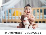 asian baby sit with teddy bear... | Shutterstock . vector #780292111