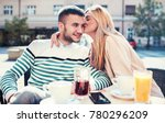 flirting in a cafe. beautiful... | Shutterstock . vector #780296209