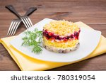 Stock photo traditional russian salad herring under a fur coat in a plate on a wooden table 780319054