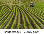 red tractor in soy beans row... | Shutterstock . vector #780395524