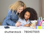 mom helps her daughter to the... | Shutterstock . vector #780407005