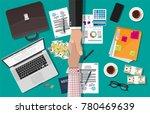 two businessman shake hands... | Shutterstock . vector #780469639