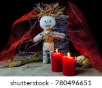 A Voodoo Altar With Doll  Red...