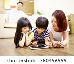 asian mother and two children... | Shutterstock . vector #780496999