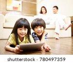 two asian children lying on... | Shutterstock . vector #780497359
