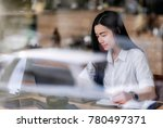 young businesswoman  using... | Shutterstock . vector #780497371