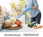 woman cleaning and polishing... | Shutterstock . vector #780504319