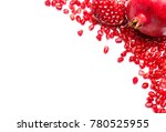 frame of pomegranate seeds on... | Shutterstock . vector #780525955