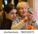 an elderly woman looks at a...   Shutterstock . vector #780535075