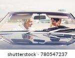 senior couple driving a... | Shutterstock . vector #780547237