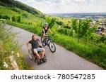 young couple in wheelchair... | Shutterstock . vector #780547285