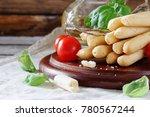 bread sticks with rosemary ...   Shutterstock . vector #780567244