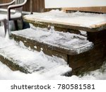 wooden steps with snow and ice... | Shutterstock . vector #780581581
