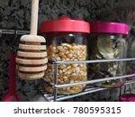 wooden honey dipper | Shutterstock . vector #780595315