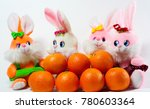 toy rabbits with tangerines | Shutterstock . vector #780603364