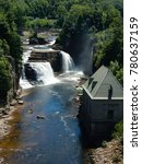 Small photo of Keesville, NY / USA - June 1, 2016: Waterfall at Ausable Chasm in New York's Adirondack Mountains.