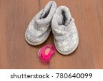 baby booties and soother on... | Shutterstock . vector #780640099
