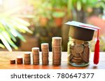 Small photo of coins saving money increase investment to student loan for concept fund finance scholarship and education