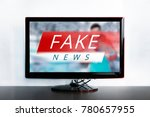 Small photo of Fake news on the TV screen, HOAX concept. News report with false news. Truth misrepresented in the news on a modern TV. Zombie TV. Deception of viewers. Corrupt journalism. Agitation and propaganda