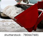 a tractor with a red bucket... | Shutterstock . vector #780667681