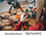 girl checking circuit board... | Shutterstock . vector #780704995