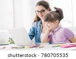 young teacher and cute girl...   Shutterstock . vector #780705535