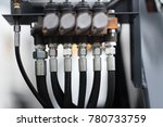 Small photo of Close up shot of hydraulic pressure hoses.