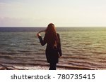 girl from the back by the sea | Shutterstock . vector #780735415