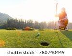 asian woman golf player... | Shutterstock . vector #780740449