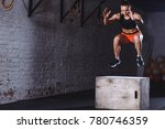 Fit Young Woman Doing Box Jump...