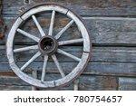 wooden wheel on wooden wall  | Shutterstock . vector #780754657