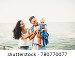 beautiful young family on... | Shutterstock . vector #780770077