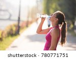 athlete woman drinking water... | Shutterstock . vector #780771751