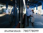 young man entering the train... | Shutterstock . vector #780778099