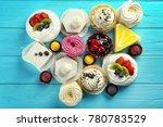 assortment of tasty sweets on... | Shutterstock . vector #780783529