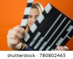 young woman in action  holding... | Shutterstock . vector #780802465