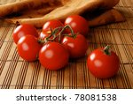A Still Life Of Tomatoes On Th...