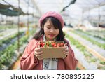 young asian girl in strawberry...   Shutterstock . vector #780835225
