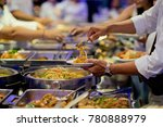 scooping the food. buffet food... | Shutterstock . vector #780888979