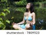 the girl mediteting on coast of ... | Shutterstock . vector #7809523