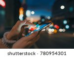 hand with a smart phone in a... | Shutterstock . vector #780954301