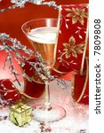 glass with champagne and gift... | Shutterstock . vector #7809808